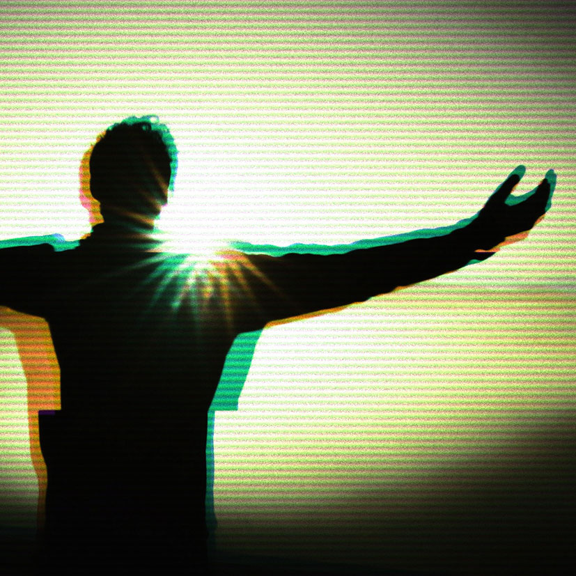 A person with their arms outstretched towards the sun.