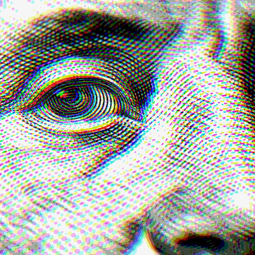 Closeup on money showing a president's eye and nose.