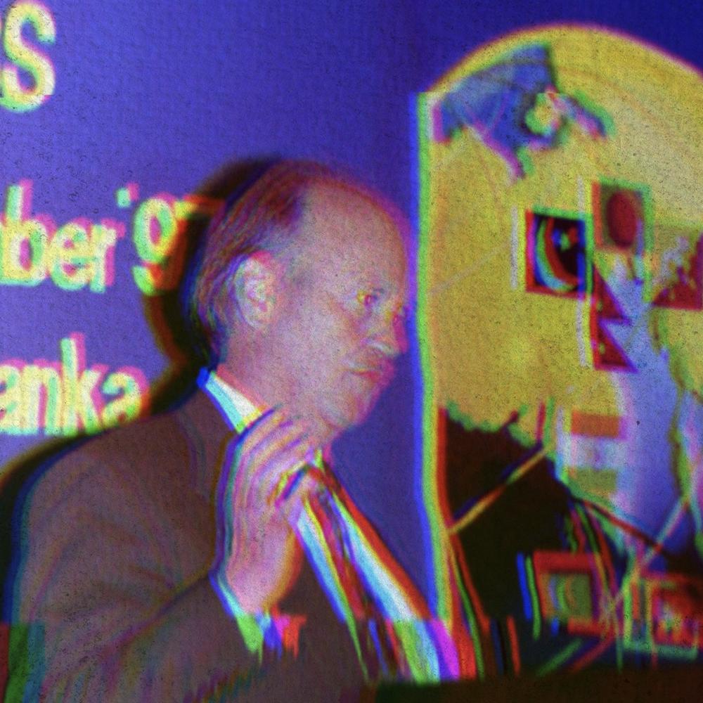 Economist John Williamson giving a speech at a podium.