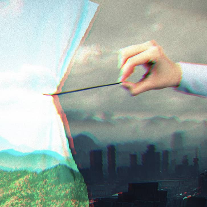 Someone pulling a curtain with image of mountains, green grass and nature over a grey, smoggy cityscape.