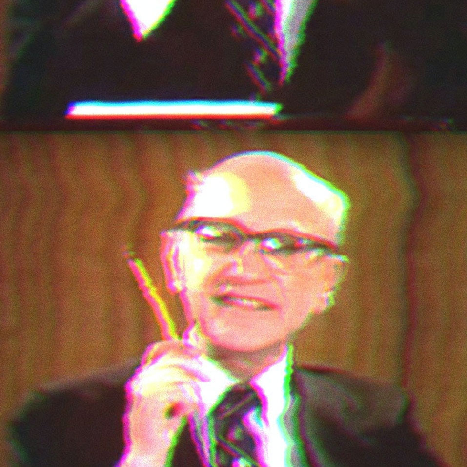 Milton Friedman Holding a Pencil.