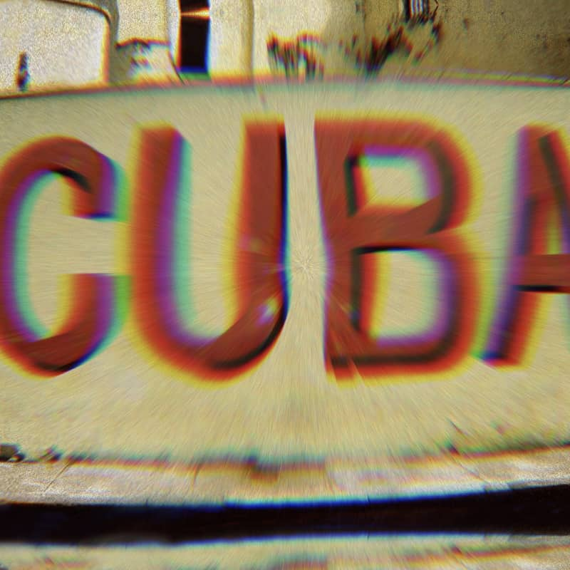 """Mural that says """"Cuba."""" A filter on the photo gives the word Cuba a rainbow glow."""