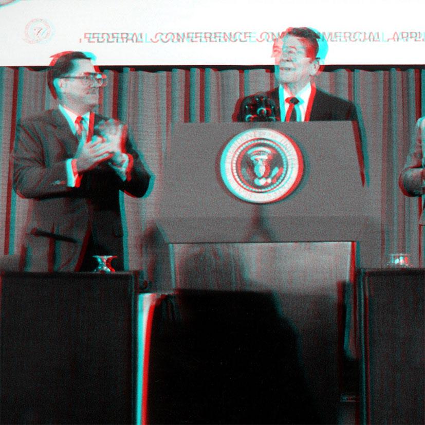 Ronald Reagan behind a podium giving a speech.